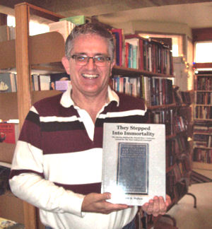 Happy Andre Maheu with the first copy of his book